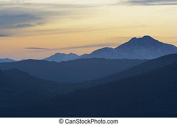 moutain range landscape - sunset scenic of a mountain range ...
