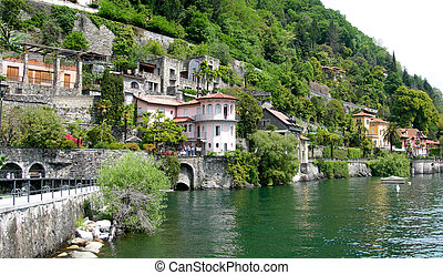 Moutain side homes in village on lake Maggiore in Swiss Italian Alps