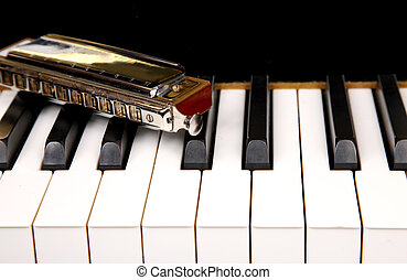 Mouth organ and piano keyboard