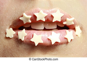 mouth - A young womans mouth with stars on lips