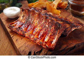 Close up Mouth Watering Juicy Grilled Pork Rib Meat on Top of Wooden Cutting Board