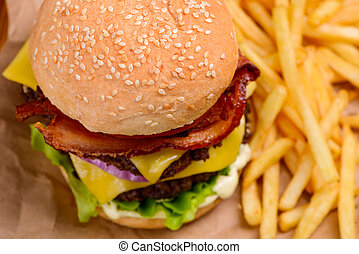 Mouthwatering double cheeseburger served with French fries