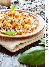 mouthwatering Pearl barley porridge with vegetables, closeup