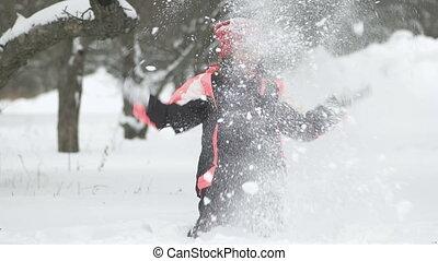 mouvement, lent, hiver, avoir, snow., dehors, enfant, amusement, girl, jouer, joyeux, jour, heureux