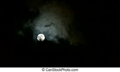 move full moon through cloudy, night flight over clouds and smoke, mystery fairyland scene.