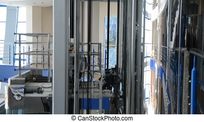 Move the elevator up and stop at a large business center. -...