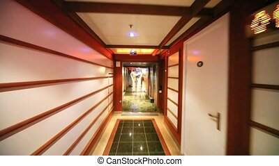 movement along corridor through door in almost empty...