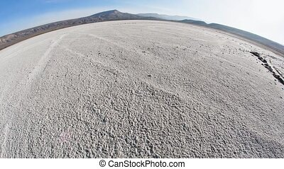 movement along the bottom of a dried lake with a convex ...