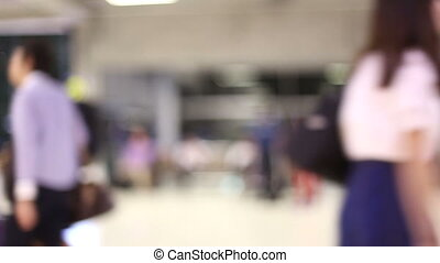Movement blurred of passenger in hall of railroad station or airport.