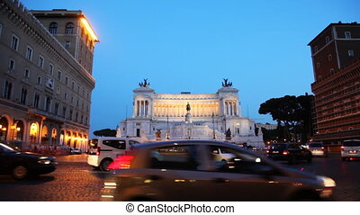 Movement cars for busy square near monument in honor of Victor Emmanuel II at Rome