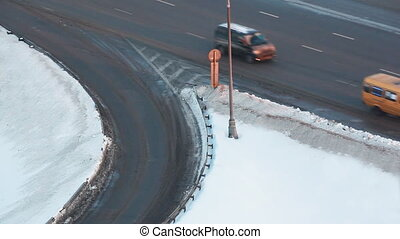 movement of cars on road turn in winter on highway