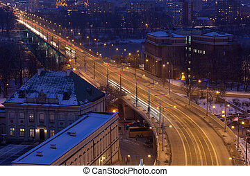 Movement of cars on the night street in Warsaw in the winter, the top view