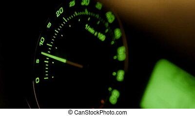 Movement of green car tachometer arrow. Engine shutdown