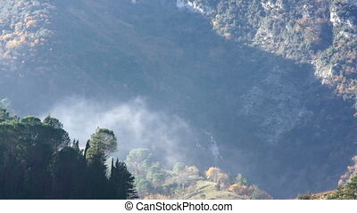 Movement of Morning fog among mountains in the fall....