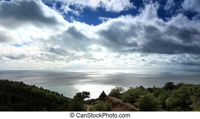 Movement of the clouds on the mountain bay Aya. Crimea, ...