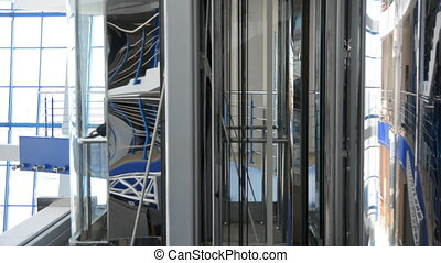 Movement of the elevator down in a large business center.