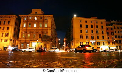 Movement of vehicles on illuminated Venice Square in Rome