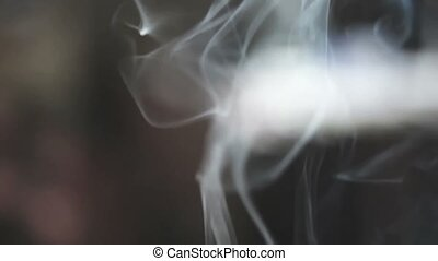 Movement of white smoke on party defocused background