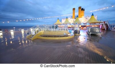 movement on almost empty stern of ship by pool to cafe bar