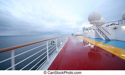 movement on empty deck of floating ship in evening