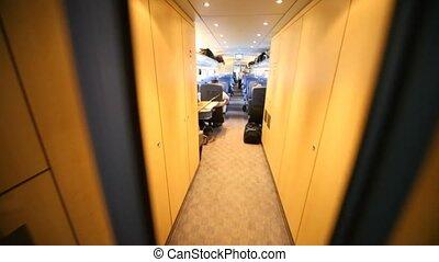 Movement on inside train between passenger armchairs