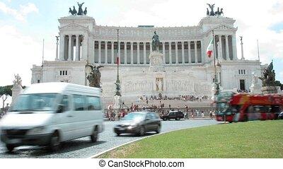 Movement on Piazza Venezia nearby Monument to Vittorio Emanuele II in Rome, Italy.