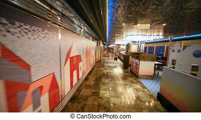 movement on rooms of empty restaurant by tables and counters...