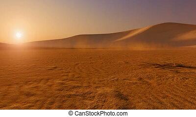 Movement through desert at sunset