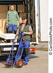 Mover two man loading furniture on truck