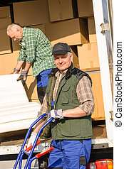 Mover two man loading furniture on truck - Two movers man ...