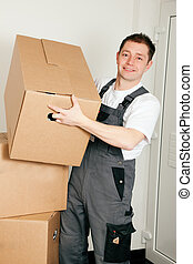 Mover with boxes in the course of relocation - Mover moving...
