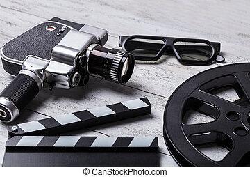 Movie Camera, Film Reel And Clapper Board