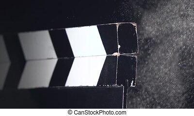Movie clapboard action . Close up. Black background - Movie...