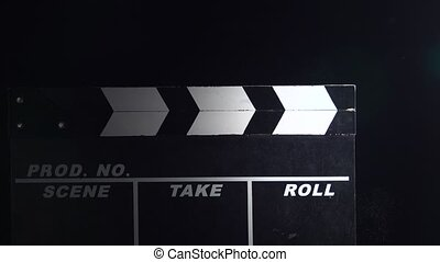 Movie clapboard action . Close up. Black background - Movie...