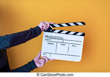 movie clapper isolated on yellow background