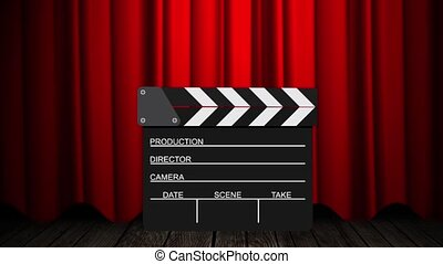 Movie clapperboard on a red background