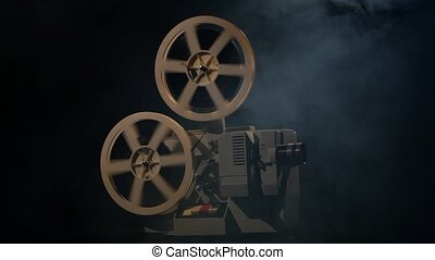 Movie ended, cine-film cut short on the projector, dark background in the studio filled with smoke, man hand presses the button stop mechanism, the reel rotate very fast, side view