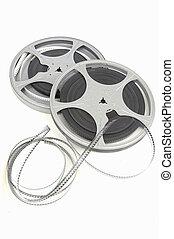 film reel - movie film reel slightly unraveled