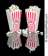 Movie popcorn in red and white containers
