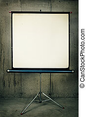 Movie Projector Screen - A blank movie screen on a concrete...