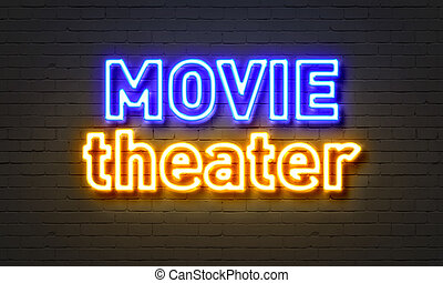 Movie theater neon sign on brick wall background.