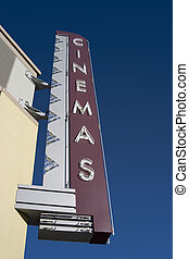A retro Cinemas sign, outside of a movie theater.