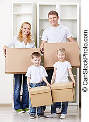 Moving - A family with two children bear box