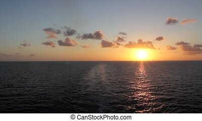 Moving across the Ocean at Sunset