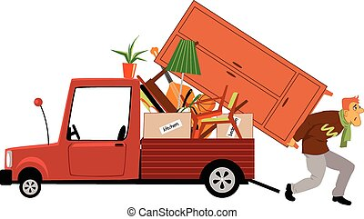 Moving - An exhausted man loading a truck with furniture,...