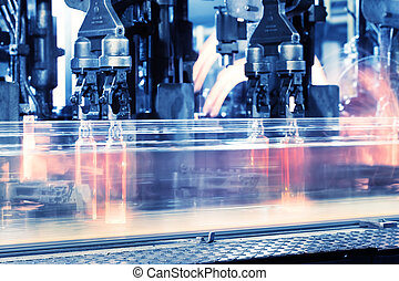 Moving assembly line for production of bottles