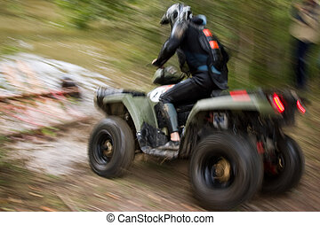 Moving ATV - Sportsman riding quad bike at extreme ...