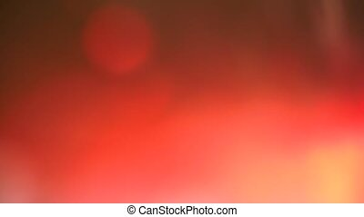 Moving background made of red and white light illuminated photographic film. Inter-frame translation.