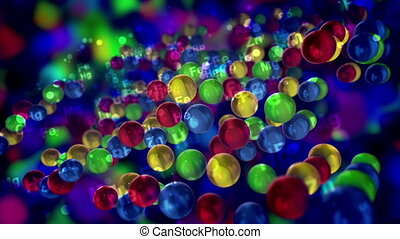 """""""An impressive 3d rendering of multicolored balls with the symbols of chemical elements placed in several flat surfaces moving up and down in the dark blue background in seamless loop."""""""