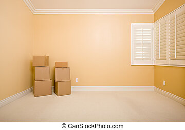 Moving Boxes in Empty Room with Copy Space on Wall